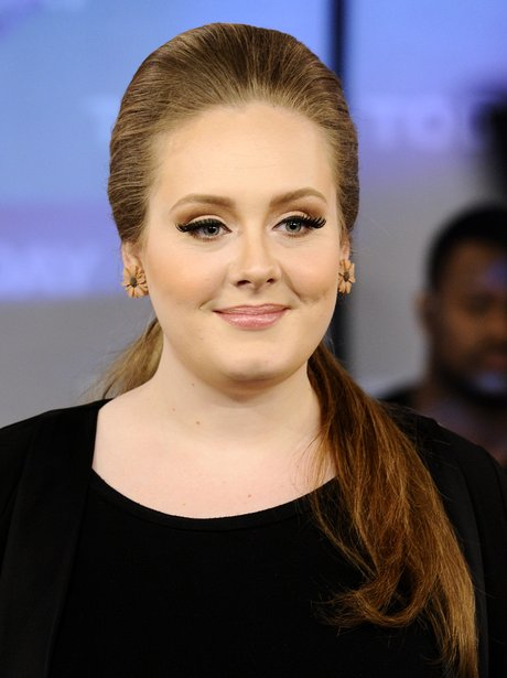 Adele smiling at camera