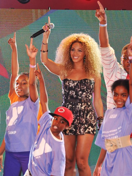 Beyonce points up to the sky