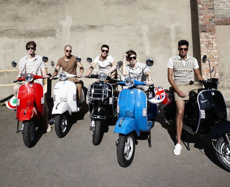 The Wanted sitting on mopeds