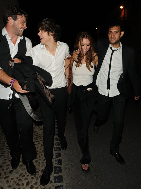 Harry Styles and Una Healy leaving Rochelle Wiseman's wedding.
