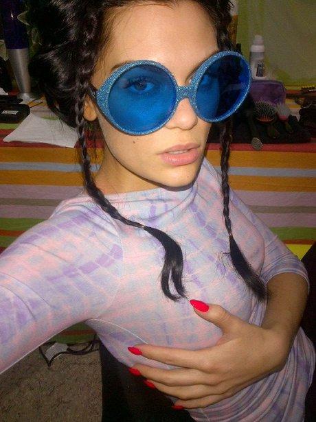 Jessie J wearing big blue glasses