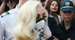 Lady Gaga wears a mask