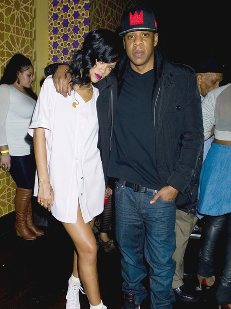 Rihanna and Jay Z pose backstage