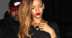 Rihanna wearing a black see-through dress