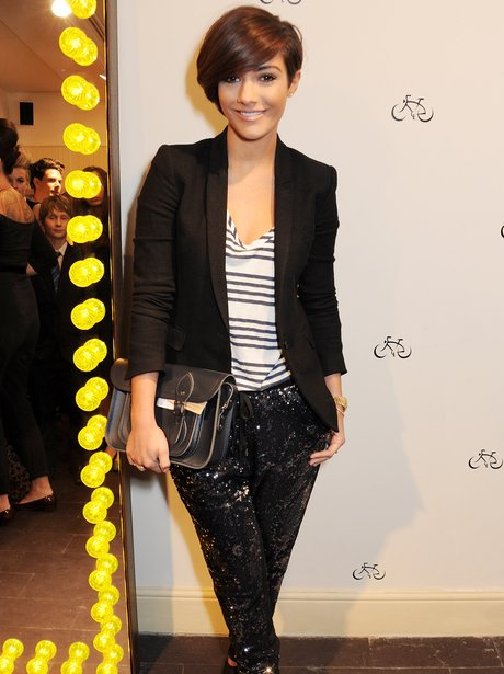 Frankie Sandford holding a leather handbag