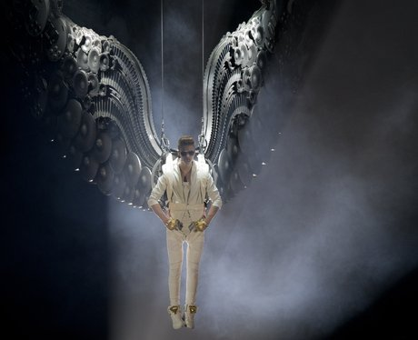 Justin Bieber dressed as an angel on his Believe tour in London