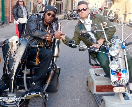 Robbie Williams and Dizzee Rascal in their 'Goin' Crazy' music video