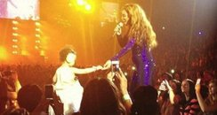 Beyonce with a todler on stage