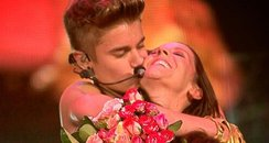 Justin Bieber and his mum on stage