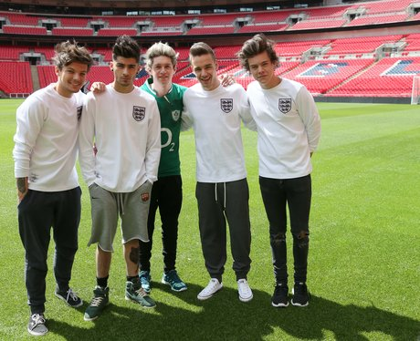One Direction wearing the England football kit