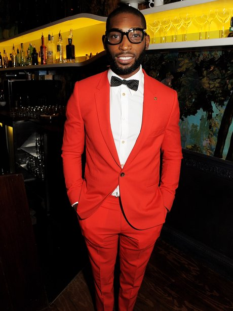 Tinie Tempah dressed in a red suit