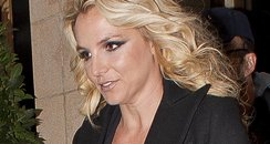 Britney Spears wearing a low cut dress in London