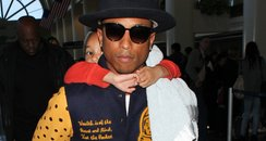 Pharrell Williams and Child Piggy Back