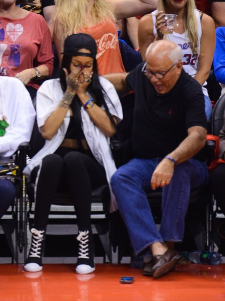 Rihanna attends basket ball game