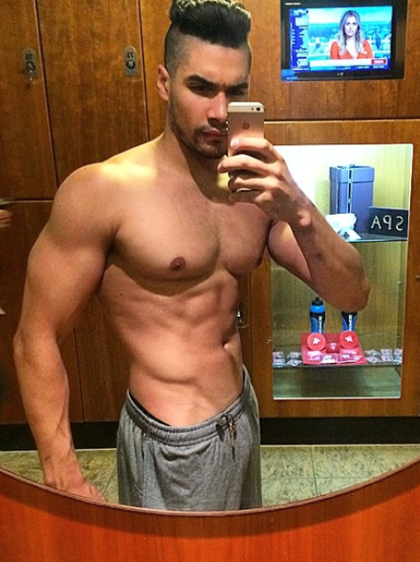 Louis Smith shows off his abs