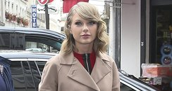 TayloR swift wearing a trench coat