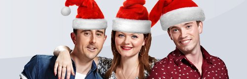 Matt, Polly and Geraint wearing santa hats