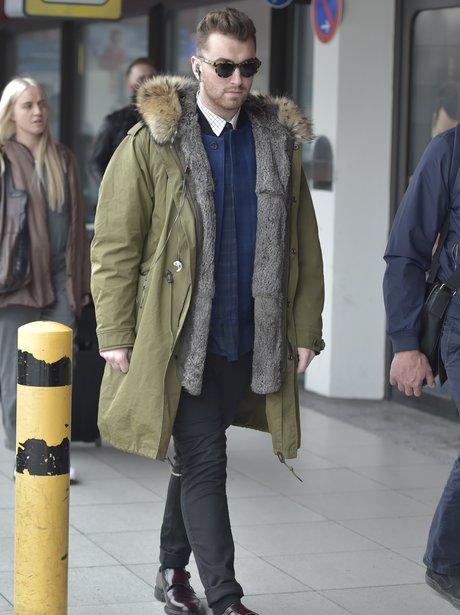 Sam Smith wearing a puffa jacket