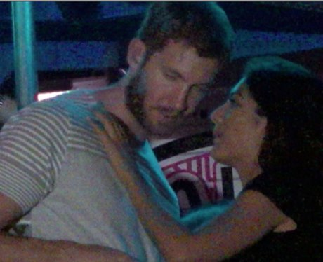 Calvin Harris gets cosy with mystery lady