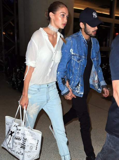 Gigi Hadid and Zayn Malik look glum whilst landing