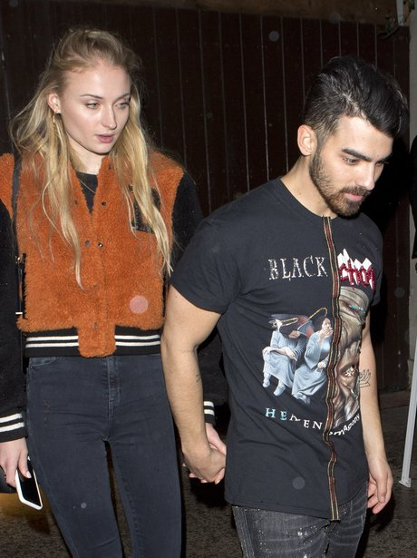 Sophie Turner and Joe Jonas hold hands as they lea